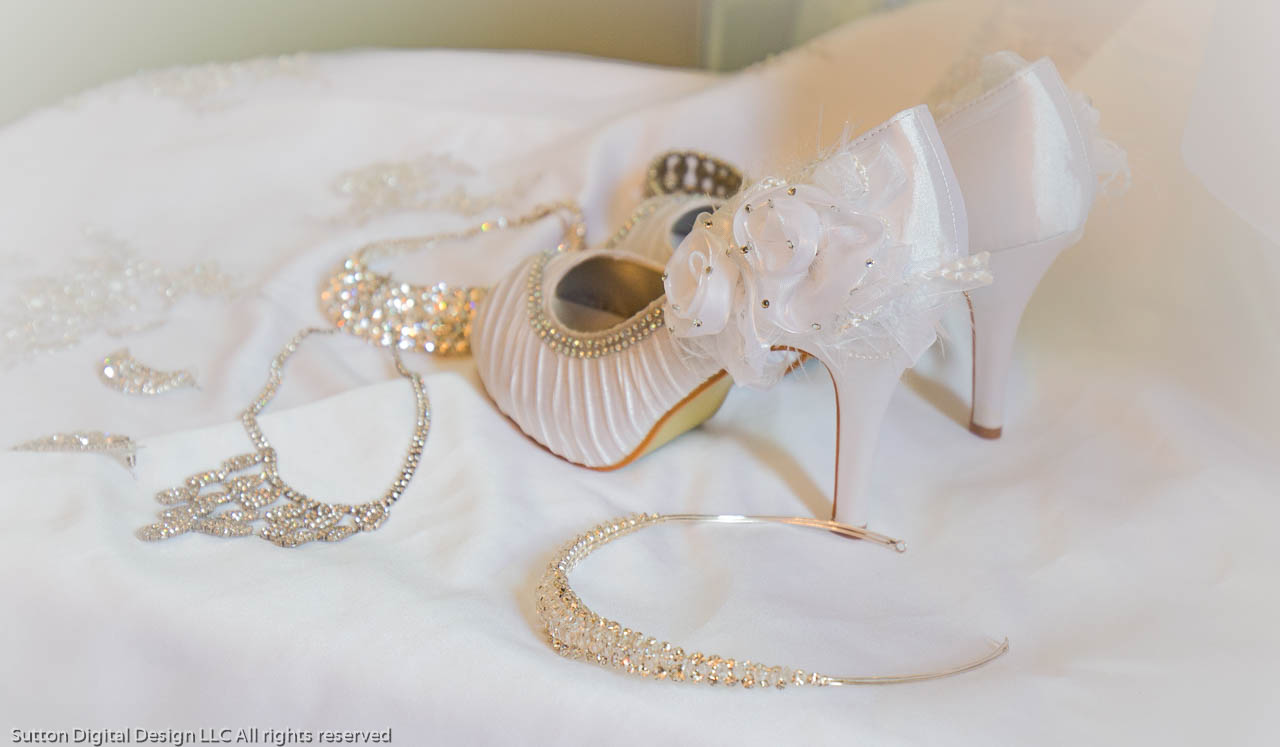 Shoes, gown and jewlery of the bride
